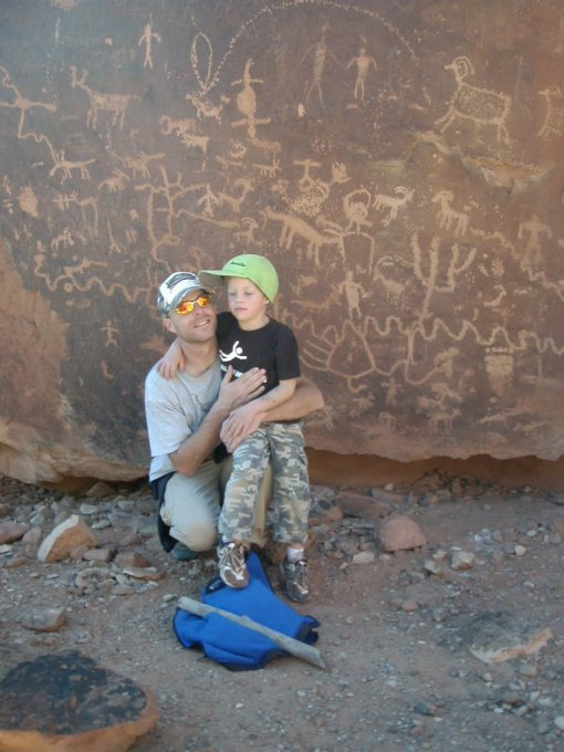 da boys in front of an impressive panel of rock art